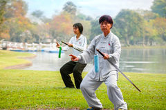Unidentified group of people practice Chinese sword with Tai Chi Chuan in a park. BANGKOK, THAILAND - FEBRUARY 20, 2016: Unidentified group of people practice Stock Photography