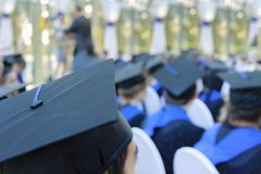 Unidentified groups of graduates in their gowns. Unidentified group of graduates in their robes waiting to graduate with their backs to the photographer royalty free stock images