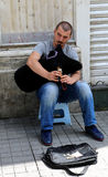 Unidentified Guy playing bagpipe to earn money at Istiklal Street Royalty Free Stock Image