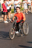 Unidentified handicapped marathon runner competes Stock Photos