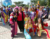 Unidentified Happy Clowns taken photo with Carnival Visitors at Orange Blossom Carnival royalty free stock images