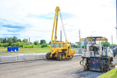 Unidentified heavy equipment stay on the road Royalty Free Stock Images
