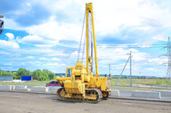 Unidentified heavy equipment stay on the road Stock Photos