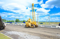 Unidentified heavy equipment stay on the road Stock Image