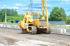 Unidentified heavy equipment stay on the road Stock Images
