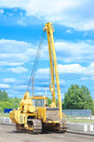Unidentified heavy equipment stay on the road Stock Photo