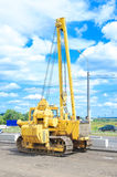 Unidentified heavy equipment stay on the road Royalty Free Stock Image