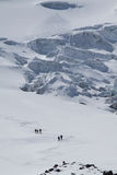 Unidentified hikers in Cotopaxi volcano, one of Royalty Free Stock Photos