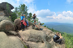 Unidentified hikers on the top of Ded rock in Krasnoyarsk Stolby Stock Photography