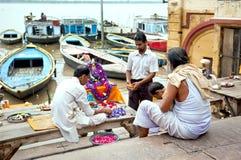 Unidentified Hindu pilgrims preparing for the Ganga Aarti ritual. Royalty Free Stock Photography