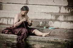 Unidentified hindu women on the sacred Ganges river banks Stock Images