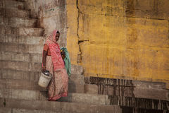 Unidentified hindu women on the sacred Ganges river banks Stock Photo