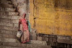 Unidentified hindu women on the sacred Ganges river banks Stock Photography