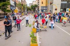 Unidentified hispanic pedestrians, skateboarders Royalty Free Stock Photos