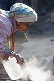 Unidentified  Hmong old woman smoking. Royalty Free Stock Photo