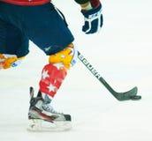 Unidentified hockey player. ASIAGO, ITALY - DECEMBER 28: Unidentified hockey player compete during the HC Asiago Migross (yellow) vs Alleghe Hockey Tegola (red Stock Photo