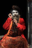 An unidentified holy man stays at the Pashupathinath temple on Feb 02, 2014 in Nepal. Stock Images