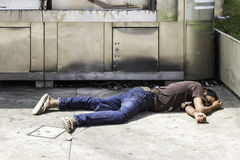 Unidentified Homeless sleeps on the street on Paulista Avenue Stock Photo