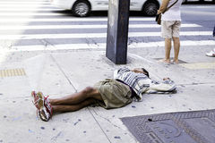 Unidentified Homeless sleeps on the street on Paulista Avenue Stock Photography