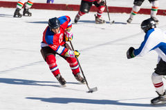 Unidentified ice hockey player challenging Stock Photos