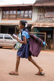 Unidentified indian girl with a heavy school bag go to school Royalty Free Stock Image