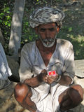 Unidentified Indian man takes a break to smoke Stock Photo