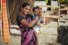 Unidentified Indian woman and baby in her arms are smiling with very royalty free stock photography