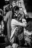 Unidentified Indian woman with child as seen in Jaipur. Working indian mother. royalty free stock photos