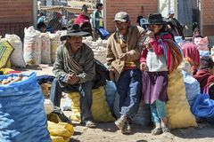 Unidentified indigenous native Quechua market traders selling fruit and vegetables at the local Tarabuco Sunday Market, Bolivia. TARABUCO, BOLIVIA - AUGUST 06 Stock Photography