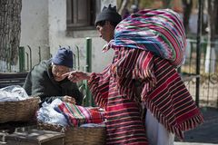 Unidentified indigenous native Quechua people in traditional clothing at the local Tarabuco Sunday Market, Bolivia. TARABUCO, BOLIVIA - AUGUST 06, 2017 Royalty Free Stock Photography