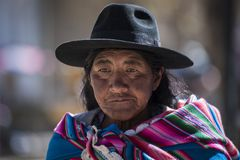 Unidentified indigenous native Quechua woman with traditional tribal clothing and hat, at the Tarabuco Sunday Market, Bolivia. TARABUCO, BOLIVIA – AUGUST 06 Royalty Free Stock Photos