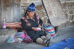 Unidentified indigenous native Quechua woman with traditional tribal clothing and hat, at the Tarabuco Sunday Market, Bolivia Royalty Free Stock Photo