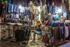 Unidentified iranian man sell clothes on the street of Urmia, Iran Stock Images