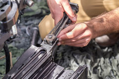 Unidentified israeli soldier hand with fragment of weapon Stock Images