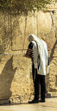 Unidentified jewish worshiper in  tallith and tefillin praying at the Wailing Wall an important jewish religious site Royalty Free Stock Photos