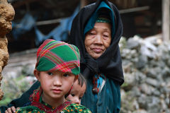 Unidentified kids in mountainous district of Dong Van Stock Photos