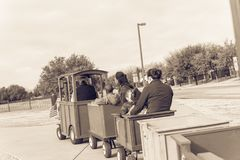 Kid trackless train ride in public winter event in Irving, Texas. Unidentified kids and parents riding on trackless train ride wagon. Public park winter event in Royalty Free Stock Images