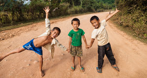 Unidentified kids posing on a road in Vang Vieng Royalty Free Stock Image