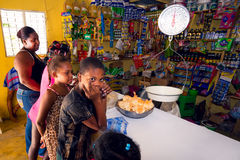Unidentified kids and woman in unidentified local shop near Cabral, Dominican Republic Royalty Free Stock Photo