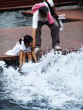 Unidentified little girl playing with water Royalty Free Stock Images