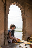 Unidentified little indian girl making traditional flower garlands Stock Photography