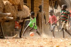 Unidentified local boys play football on the Orange island stock photos