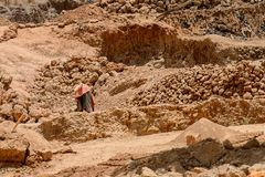 Unidentified local man collects clay for building houses. stock photography