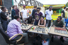 Unidentified local people played chess at Brick lane street Stock Images