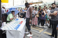 Unidentified local people played chess at Brick lane street in London UK. LODNON, 17 August 2017. Unidentified local people played chess at Brick lane street in Royalty Free Stock Image