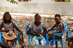 Unidentified local people sit by the table full of empty bottle royalty free stock photos
