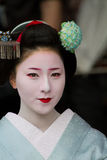 Unidentified Maiko on. KYOTO, JAPAN - JUNE 5: Unidentified Maiko on houjoue event stands on the famous Shirakawa street in the Gion district on June 5: , 2011 Royalty Free Stock Photos
