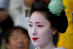 Unidentified Maiko on houjoue event. KYOTO, JAPAN - JUNE 5: Unidentified Maiko on houjoue event stands on the famous Shirakawa street in the Gion district on Royalty Free Stock Photos