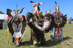 Unidentified male Native American dancers wears traditional Pow Wow dress with Dance Bustle during the NYC Pow Wow Royalty Free Stock Photos