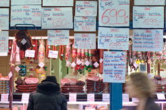 An unidentified man buying meat at a butcher Stock Image